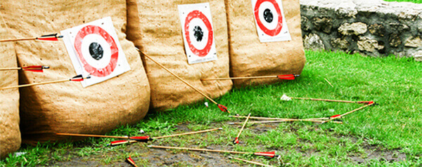 Several arrows on the ground that missed the target